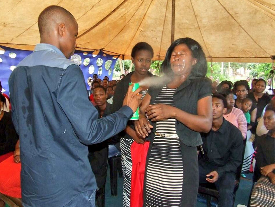 Pastor Lethebo Rabalago of Mount Zion General Assembly in Limpopo sprays insect killer on a congregant. Picture: Facebook